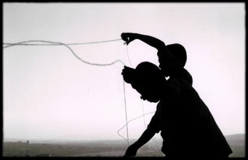 http://kapkara.deviantart.com/art/the-kids-with-a-kite-11726807